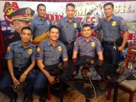 Guillen on the left in their PNP GOA type C uniform