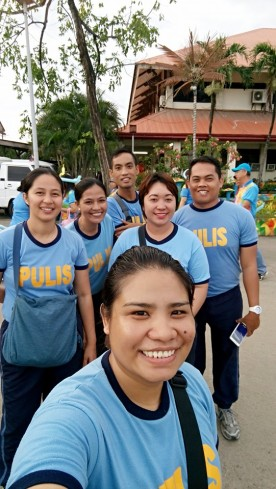 Guillen at the center in their PNP athletic uniform